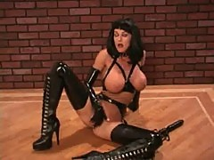 Latex girl with dildo
