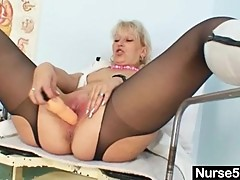 Blond milf in latex uniform extreme dildo insertion
