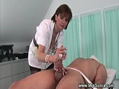 Dominatrix nurse takes care of dick