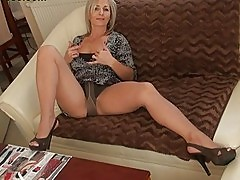 Handsome blonde momma in pantyhose does striptease act