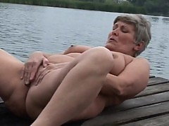 Granny masturbating and pissing outdoor