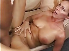 Busty blonde momma gets her shaved nookie streched by black ...
