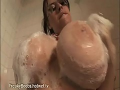 Big tit babe takes shower and gets soapy