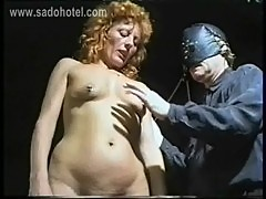 Beautiful milf slave with her pussy and nipples pierced got