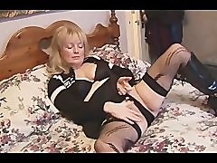 Mature busty blonde babe in stockings and mini skirt striptease