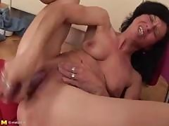 Mature Brunette Gets Off Shoving Her Purple Dildo In Her Twat