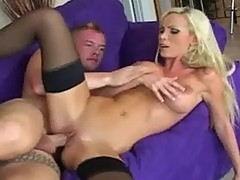 Blonde with big tits fucked in black stockings and high heels