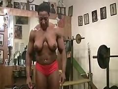 Body Building Ebony Carmela Is Working Out Topless Showing Boob