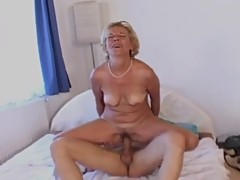 Attractive Granny with Glasses Fucks Her Toy Boy
