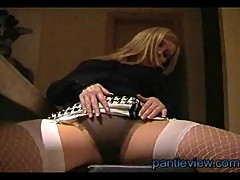 Blond milf gives upskirt views