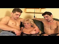 Granny gets two young hard cocks