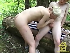 Outdoor sex on a log