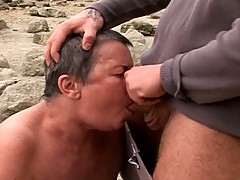 Slutty granny fucked by the beach
