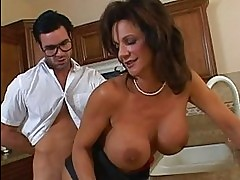 Stunning busty brunette milf getting her cunt fucked hard