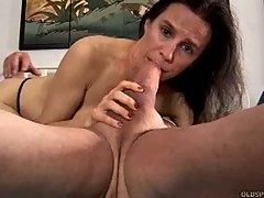 Mature wife gives a foot job and sucks cock for a mouthful of cum