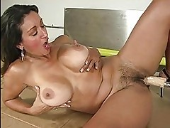 Tanned busty milf gets fucked by fucking machine