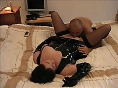 Milf in latex gives head