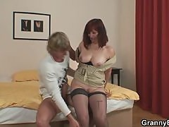 Mature redhead fucking with young