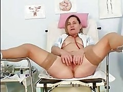 Unpretty elder mom wears stockings and toys hersel