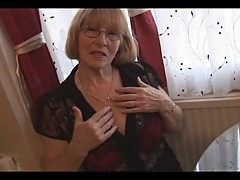 Sexy granny in pantyhose striptease