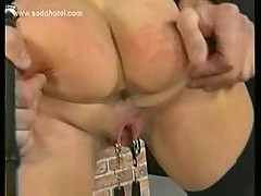 Scared looking milf slave with nice tits gets her pussy spre