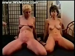 Two ladies getting spanked hard on their cunt and asses