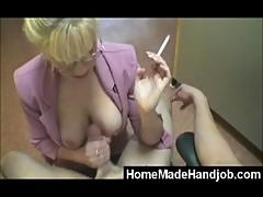 Smoking milf gives handjob to young guy and makes him cum