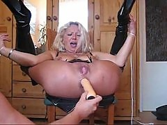 Anally toyed until her pussy squirts