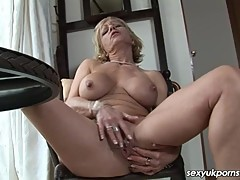 British mature pornstar dildos her pussy in the study