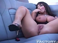 Busty milf solo dildoing in a car