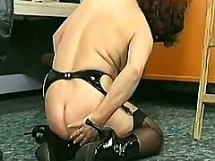 Masked milf slave crawling over the floor and metal clamps o
