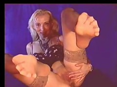 MILF dildos pussy and gives fantastic nylon foot show!