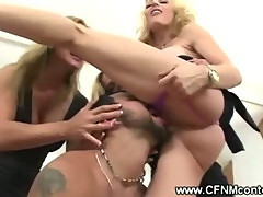 Clothed milfs hitting stiff cock with a belt