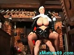 Horny mature nun in latex with slave