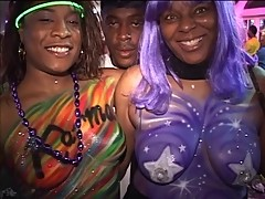 Black girls stripping, flashing, and getting their breasts painted