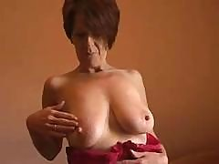 Mommy In Stockings Flashes Some Of Her Sexy Skin In Front If Camera
