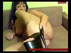 Hot Brunette Milf Digs Her Heel Inside Her Pussy And Asshole